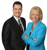 Photo of Linda & Tim Domis - The Domis Team Real Estate